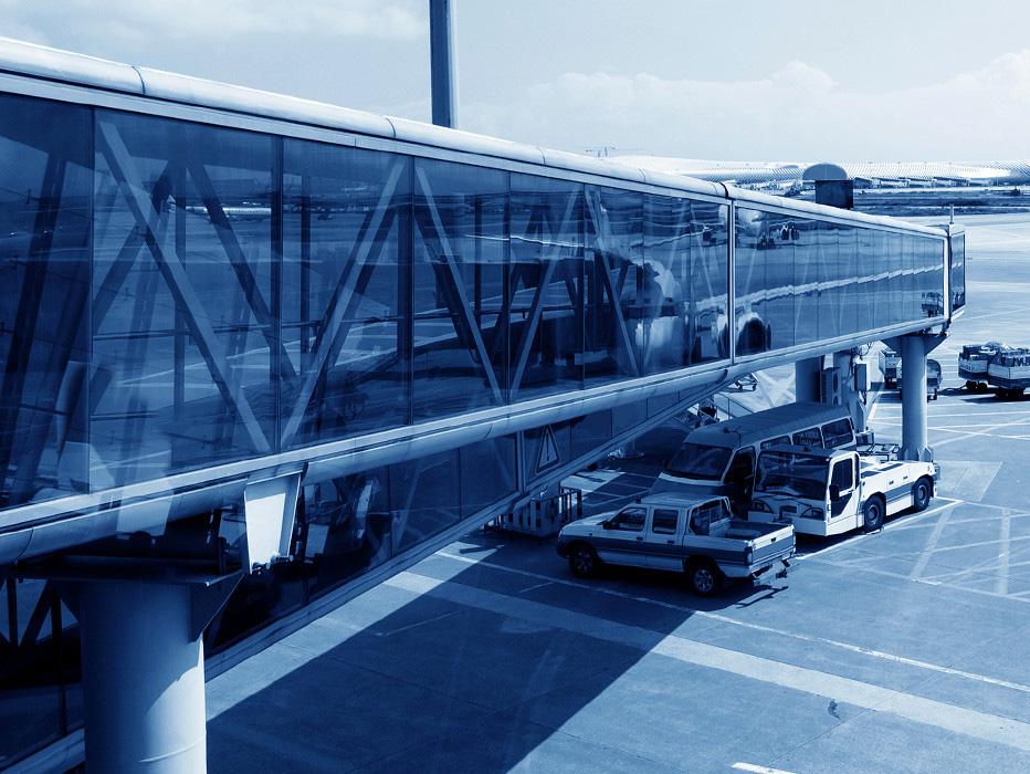 Airport jet bridge and service vehicles