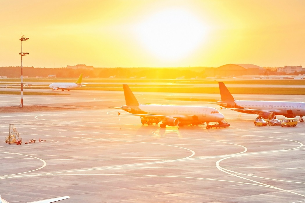 Airplanes on runway at sunset