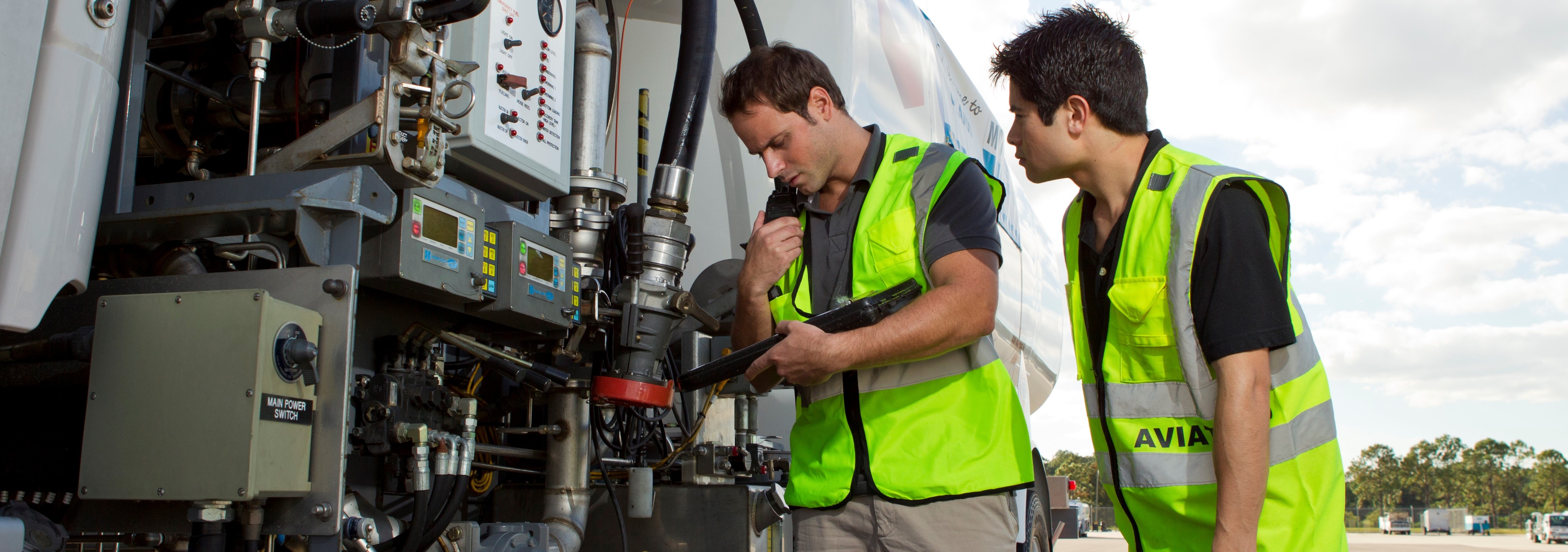 Two employees operating plane refueling truck
