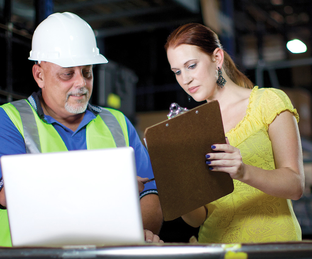 Woman consulting with warehouse manager