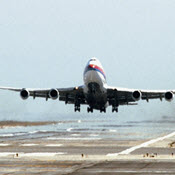 Airliner lifting off of runway