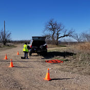 Rural sUAS operation setup blocked off by traffic cones