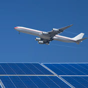 Jet flying over solar panels