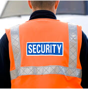 Airport officer in security vest