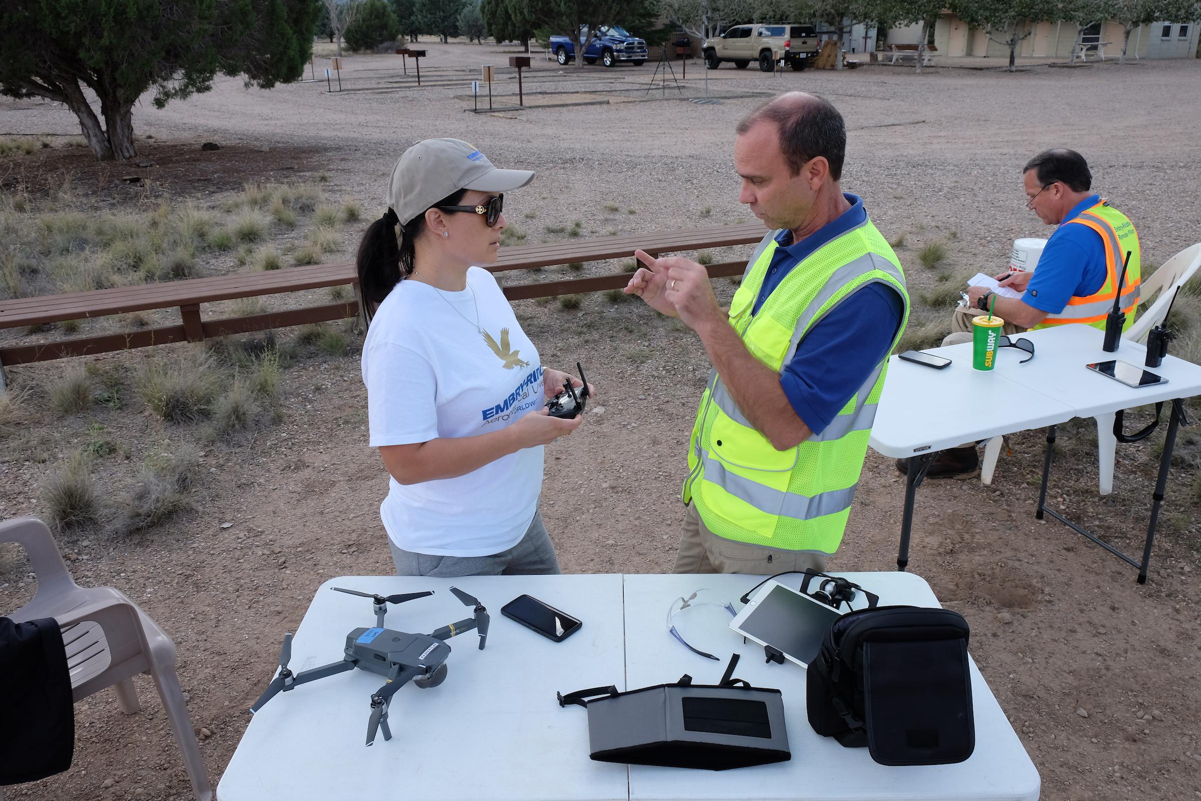 sUAS instructors and operator preparing for flight
