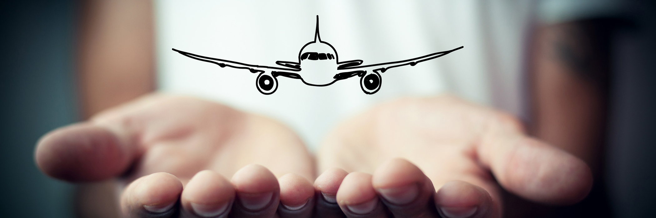 airplane nestled inside hands